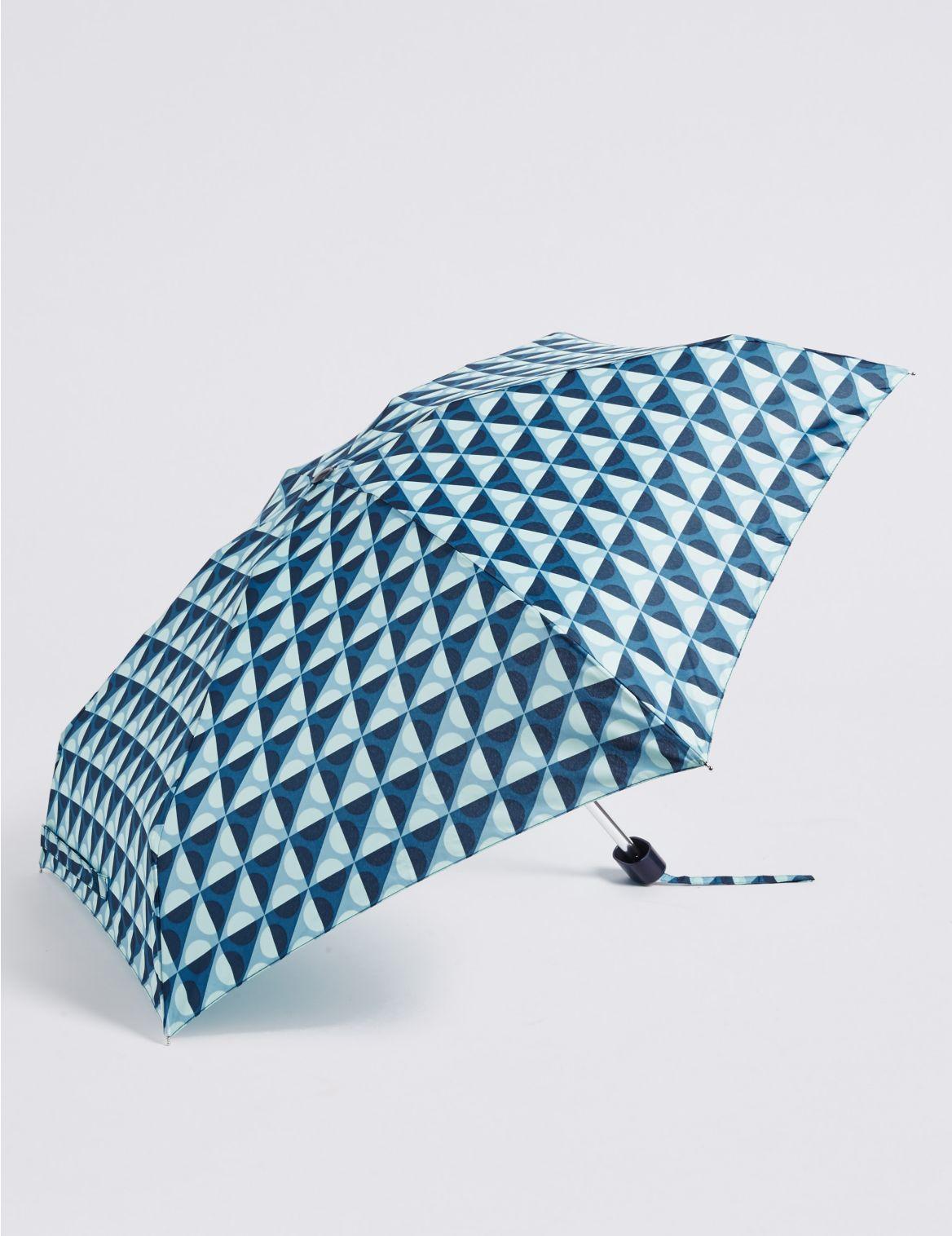 Parapluie compact à pois, doté de la technologie Stormwear™