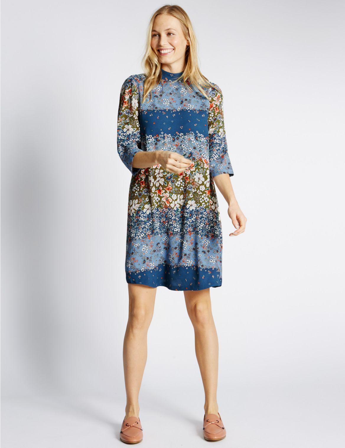 Wijd uitlopende jurk met 34mouwen