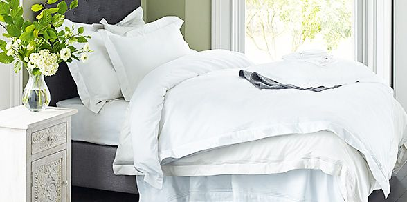 White bedding on a bed