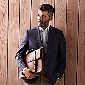 Man holding tan leather mens briefcase