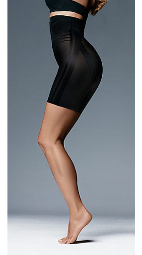 A woman wearing some black shapewear