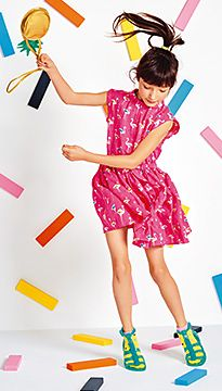 Girl wears M&S Flamingo Print Belted Dress