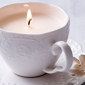 A candle in a tea cup