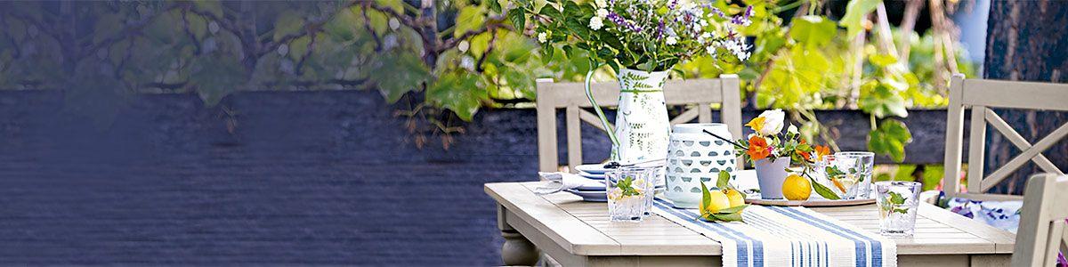 An outdoor dining table and chairs from our Dahlia range