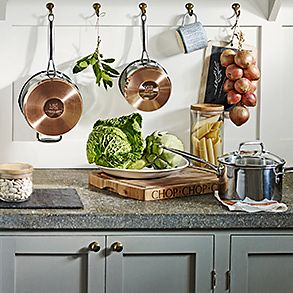 Kitchen worktop with copper pans