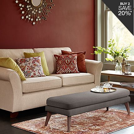 A fabric sofa and footstool