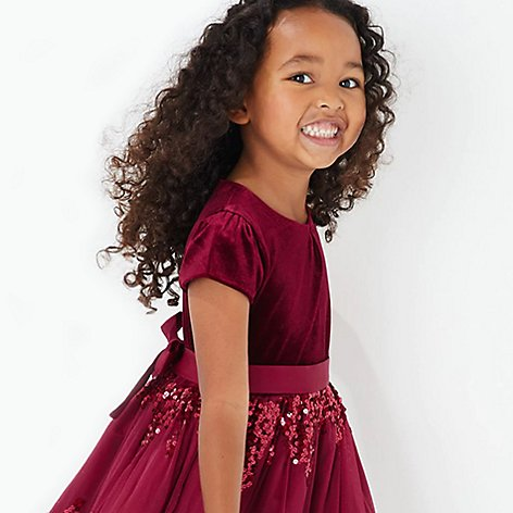 Girl wearing red party dress