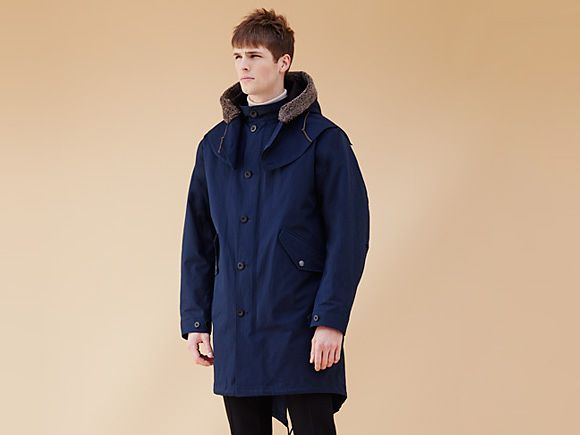 Man wearing blue parka coat