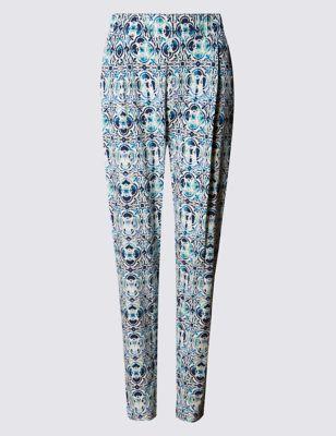 Зауженные брюки с мозаичным принтом
