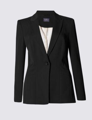 Пиджак с остроугольным лацканом и вертикальной строчкой