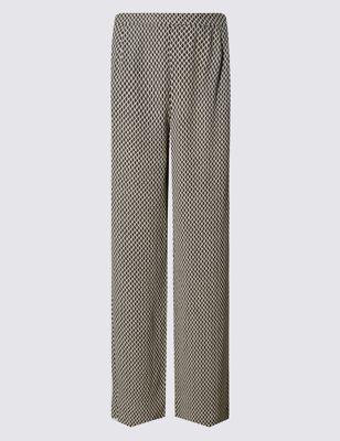 Широкие брюки с мелким геометрическим принтом