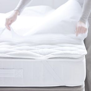 A mattress protector and mattress topper