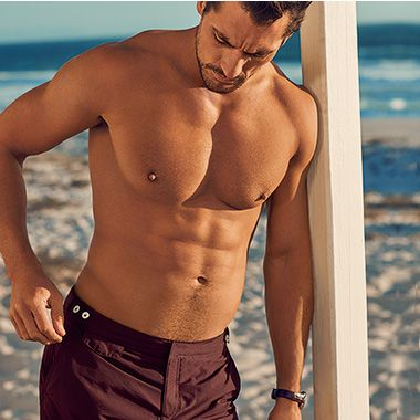 David Gandy in maroon swim shorts
