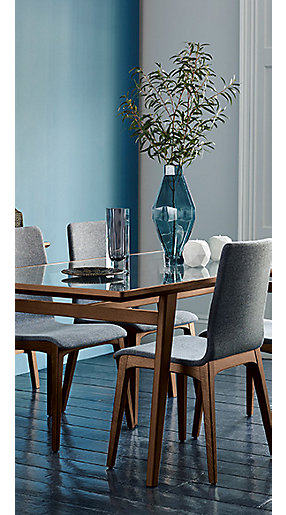 A wood and glass dining table and chairs
