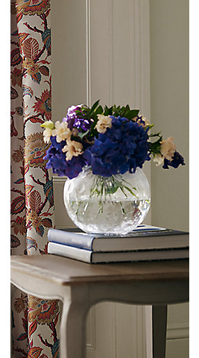 Artificial flowers in a glass vase