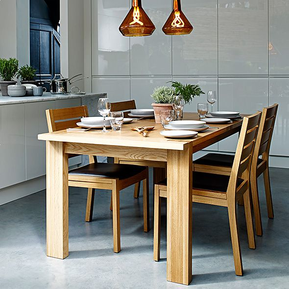 A wooden dining table with dining chairs