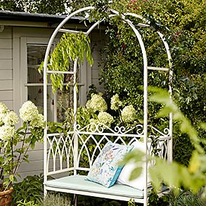 A garden bench with arbour