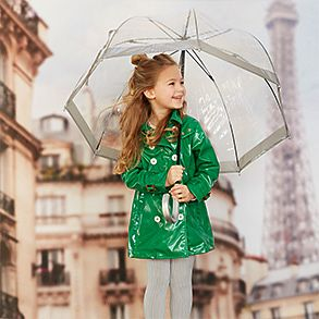 Girl wearing green rain mac