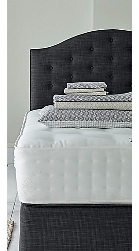 A sprung mattress with bedding