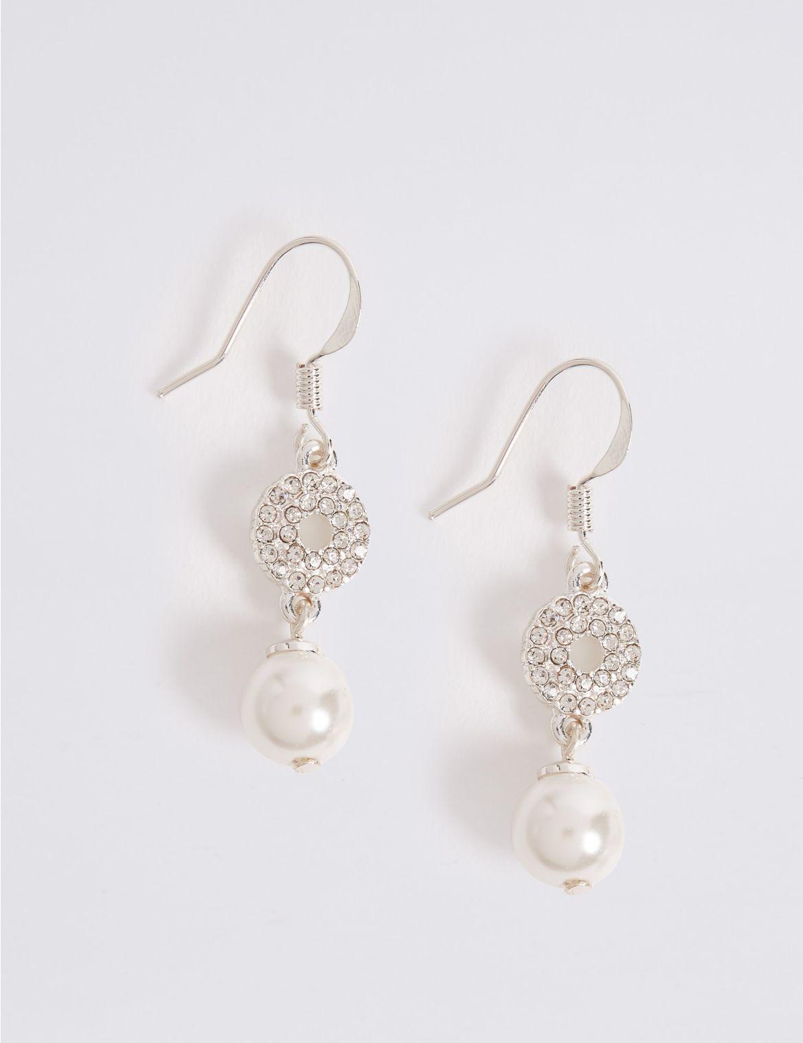 Boucles d'oreilles composées de disques incrustés et de perles