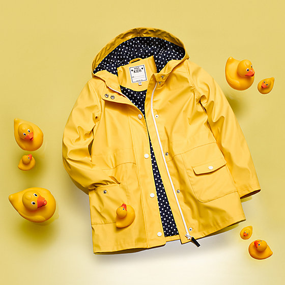 f094f809e472 This yellow mac keeps the rain off kids