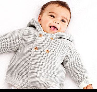 Baby in grey chunky knit cardigan