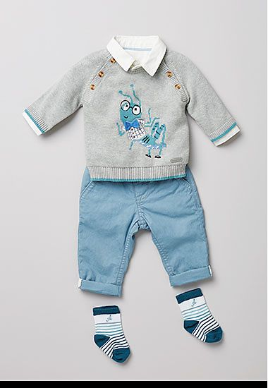 Grey cricket print jumper and blue trousers with socks